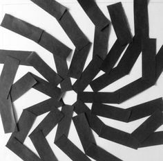 This is made by construction paper comparing positive and negative space.