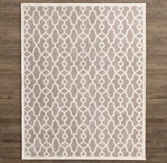 RH Baby & Child's Camden Gate Rug:Hand tufted in pure wool and cotton, this rug treats little feet to plush, lofty softness. An interlacing ivory motif, inspired by a vintage garden gate, lends soft contrast to the pastel colors, and the entire surface is sheared to a smooth, even finish. Hand-hemmed edges complement the rug's artisan-crafted character.
