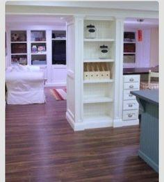 In basement build cabinet storage space around support poles #builtins basement ideas #storage #organize #smartspace