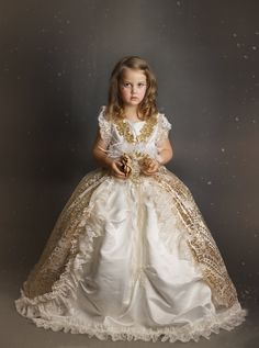 "Once Upon A Time, There Lived A Little Princess...Introducing ""Gold Dust Fairytale"" Our Gold Dust Fairytale gown epitomizes bold, one of a kind fashion, with a gorgeous feminine edge. This stunning iv"