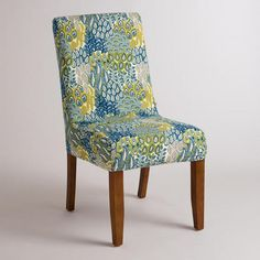 One of my favorite discoveries at WorldMarket.com: Feather Blue Anna Chair Slipcover  If you decide to change the dining room chairs in the future. Good pattern with lots of bold colours that we can pull from