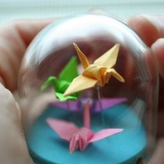 Origami inspires Vixie Dean to make all sorts of pretty jewelry.   Put Origami figures in a mason jar instead?