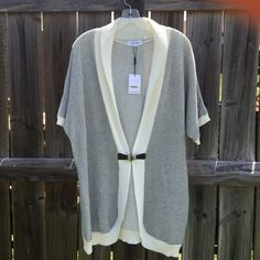 Calvin Klein Sweater Short sleeve sweater with buckle. This sweater can also be used for fall & winter with a white long sleeve turtle neck. Calvin Klein Sweaters