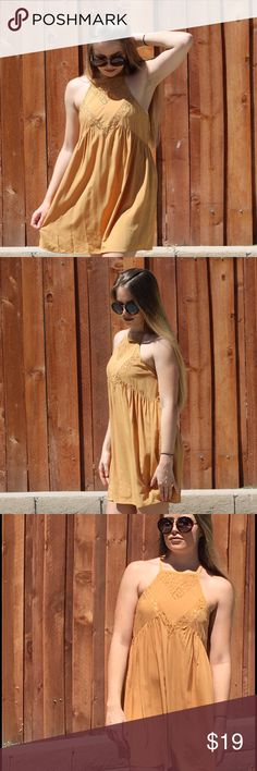 Tan mini dress Light and airy, this cookie is great for the heat. Slide on your favorite ankle boot or sandal and have at it. Perfect for those breezy days you just want to be free. Model is wearing a small. Dresses Mini