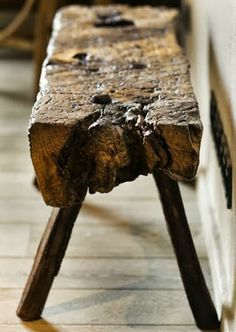 Beautiful hand-crafted table made from roughly hewn wood.