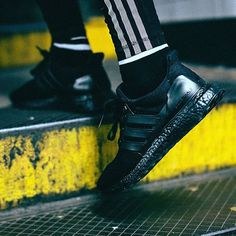 """The adidas Ultra Boost """"Triple Black"""" releases on December 1st in the US, but you can win a pair if you live in NYC (and run really fast). For more details on how to secure your pair, tap the link in our bio."""