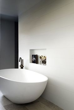 "A luxurious oversized bath from [ACS Designer Bathrooms](http://www.acsbathrooms.com.au/|target=""_blank""). Above the bath in a niche in the wall is a painting by Gria Shead."
