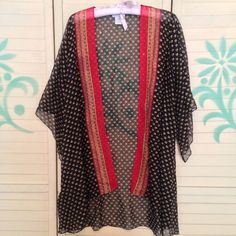 """SHEER BOHO FLORAL KiMONO  Gorgeous sheer and flowy kimono style layering piece. Black tan, red, and gold prints. Perfect for the spring and summer seasons! By Soft Surroundings. Size Large. 100% polyester. Chest measures 44"""". Length 29-34"""". Sleeve 13-20"""". Good pre-owned condition with no holes, rips, or stains.  KWs: gypsy chic, printed, calico, paisley, layers, beach, coverup, western, trendy Tops"""