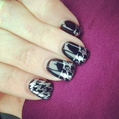 Black Gelish over acrylic, stamped in houndstooth with OPI silver polish.  My nail tech is amazing!