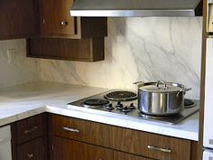 ...I painted my Formica kitchen  countertops  to look like marble.   I have received a lot of questions about how it was holding up over t...