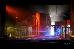 Set and lights for Urinetown at ICT MainStage. Great use of lights, set, color, positions, fog, etc.