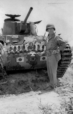 Type 97 Shinhoto Chi-Ha (Type 1 47 mm L/53,7)    : Marine General Thomas Watson in front of an abandoned Japanese Type 95 Ha Go light tank from the 9th Tank Regiment. The photo was taken after the June 17/18 1944 tank battle on Saipan--the largest of the Pacific War.