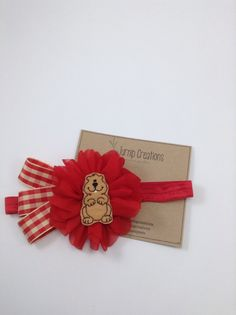 Even Groundhog Day deserves a cute Headband! A red headband with a red ballerina flower centered with an adorable felt groundhog and complimented with