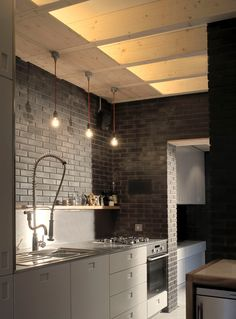 [KILLLLLER! LOVE the black brick and the plywood ceiling! IN fact, the brickwork in the entire house is amazing!]