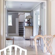 Neutral country hallway with flagstone floor | Hallway decorating | Country Homes and Interiors | Housetohome.co.uk