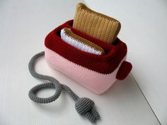 So cute! Check out this amazing crocheted toaster with removable toast! See SkyMagenta for some more awesome food art.