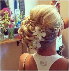 Like this, but flower on top and to the side more and not so tight..more fun and relaxed and loose!