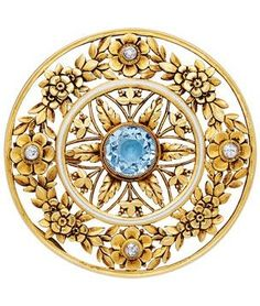An Art Nouveau Aquamarine, Diamond and Enamel Brooch, France, circa 1900. Of pierced circular design, the outer section chased with floral motifs and accented by small old mine-cut diamonds, the inner circle of white enamel enclosing a foliate pattern and centred by a round aquamarine, mounted in 18k gold, with French assay mark, maker's mark and numbered.