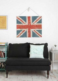 black linen love seat against white walls