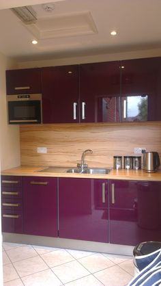 Our Intoto compact kitchen.great for smaller spaces. Here we have used the Calla high gloss door in Aubergine. Small Kitchen Decor, Compact Kitchen Furniture, Tiny House Kitchen, Kitchen Furniture Design, Purple Kitchen Cabinets, Kitchen Room Design, Kitchen Remodel Small, Modern Kitchen, House Design Kitchen