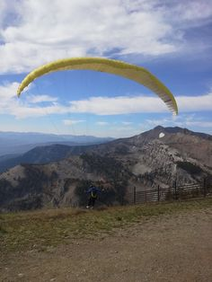 Grand Tetons National Park- Parasailor just taking off from the summit of Rendezvous Mountain, Jackson Hole, Wyoming