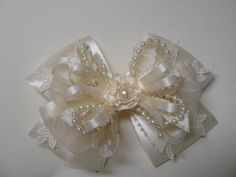https://www.etsy.com/listing/225935326/ivory-or-white-satin-hair-bow-big-large?ref=shop_home_active_23