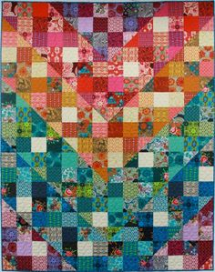 I am not a quilter, but this is a fun visual effect, in easy squares and half squares, mostly because of the rainbow scrappy effect