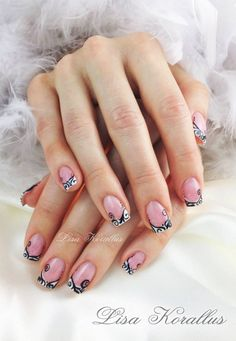 Pink and whites with black scroll design gel enhancement. #pinkandwhites #frenchnails #gelnails #nailart #handpaintednails #naildesign #nails #lisakorallus #liquidglamour #nailpictures