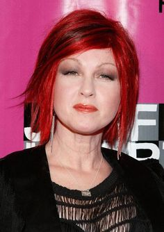 dark cherry red lowlights on pure red hair...razored edged  bob with heavy side bang