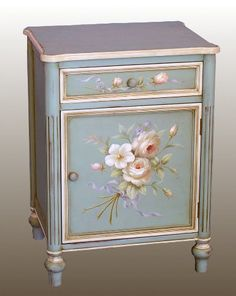 Pink roses on blue cabinet