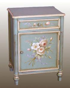 Pink roses on blue cabinet                                                                                                                                                      Más                                                                                                                                                     Más