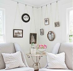 PVC pipe attached close to ceiling using curtain hangers, add on S hooks and decorative chain or rope... whatever, Good to hang those hats on.