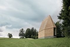 This small, wood-clad chapel on a grassy hill in western Austria was designed by Bernardo Bader Architects to feature a worship space with a steeply pitched ceiling.