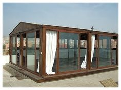 Glass yoga studio - would be great to have this in the backyard!
