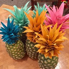 Vibrant painted pineapple centerpieces