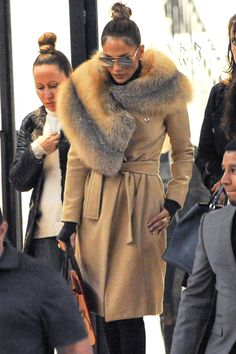 Best Celebrity Coats: Jennifer Lopez in a camel coat with oversize fur collar