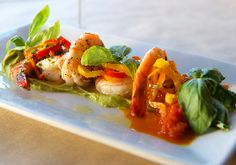 Citrus Marinated Prawns with Haas Avocado Puree, Fresh Basil, Piquillo Pepper Coulis and Preserved Lemon.