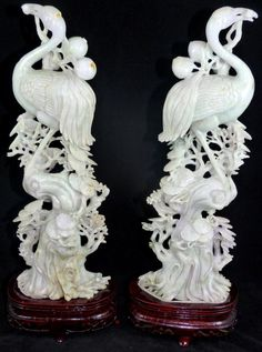 """PAIR OF JADEITE DEEP RELIEF CARVING PHOENIX BIRDS  This perfectly matched pair of Phoenix birds is carved in deep relief from genuine solid jadeite jade, one of the hardest stones to carve from. 19th century. No apparent signature. Each measures approximately 14 1/4"""" height + 3 1/4"""" base(36.2cm +8.2cm)"""