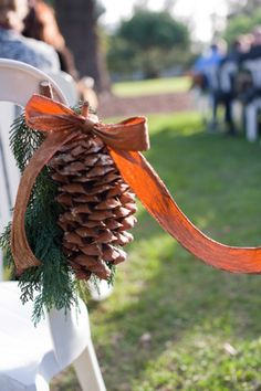 Pine cones line the aisles for fall or winter wedding