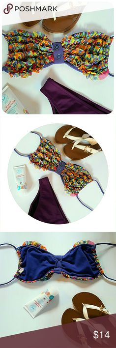 XHILARATION MEDIUM BANDAGE BANDEAU BIKINI TOP Pre owned-good condition. No flaws. Base color: plum purple with multicolor mini ruffles across the front. The center had a vertical band accented with buttons. Style: bandage bandeau bikini top. 2 parallel string tie closure. The Tory Burch flip flops shown in picture are also for sale in a separate listing! DISCOUNTED BUNDLES AND FREE GIFT WITH EVERY PURCHASE! Xhilaration Swim Bikinis