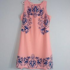 """Pink/coral  and Blue Dress! Very pretty like pink/peach dress. Blue stencil designs. It does need a slip underneath it. Small spot on the dress. I think it could be washed out. Not very noticeable. Fits like a small. I am 5'4"""" and it is above my knees by quite a bit. Dresses Mini"""