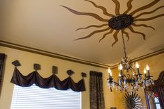 Hand painted Sunburst design in the formal dining room ceiling by Nisha Tailor interior Design, LLC