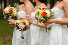 Bridesmaid bouquets of red and blush roses, green viburnum, and white hydrangeas {Tracey Buyce Photography}