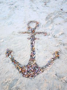 this would be cool in a picture frame, making the anchor out of sea glass and using a glue/sand mixture to fix it on there