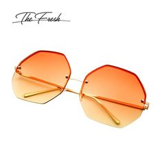 d469ab643d Amazon.com  The Fresh Fashion Designer Oversize Hexagon Metal frame Ocean  Colored Lens Women Sunglasses with Gift Box (Gold