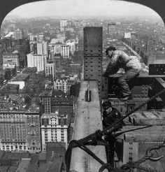 DANGEROUS LABOR: Workers building the Metropolitan Tower during its construction in Manhattan. Two men work on beams of the Metropolitan Tower during its construction in Manhattan. June 12, 1908