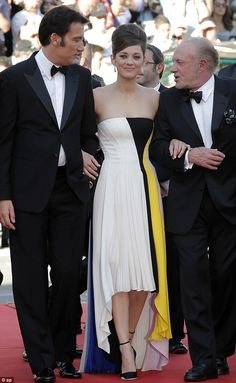 All eyes on her! Marion Cotillard steals the show on the red carpet at the 66th Cannes Film Fetival - her Blood Ties co-stars Clive Owen and James Caan can't take their eyes off her