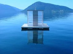 This floating sauna in Norway is anchored in the middle of a fjord with the winter sun coming in through transparent walls. Access to the sauna is by boat and users can descend into the fjord water for an icy dip through a hole in the floor. Finnish Sauna, Luxury Pools, World Photo, Boat Building, Around The Worlds, Exterior, Wellness, Lap Pools, Indoor Pools