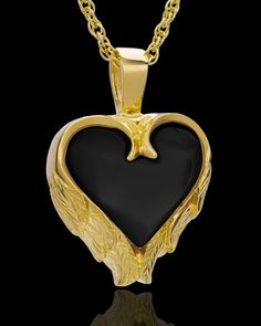gold plated urn heart with etched wing design around a black onyx center heart, loop bale at top, comes with gold link chain