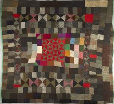 Welsh patchwork quilt. Made from pieces of wool and flannel which would have been off cuts from a dress maker or tailor.